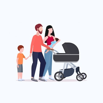 Young parents pushing stroller walking with children happy family having fun together parenthood concept  full length