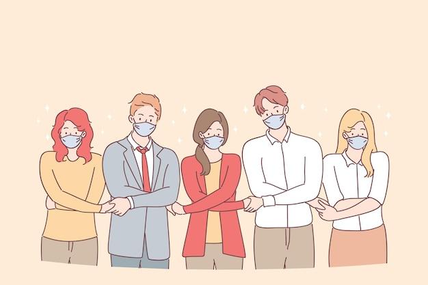 団結の努力と共通の目標の象徴として立って手をつないでいる若者のビジネスパートナーまたは創造的な同僚