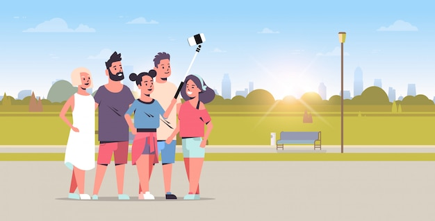 Young people group using selfie stick taking photo on smartphone camera friends standing together city urban park sunrise landscape background full length horizontal vector illustration