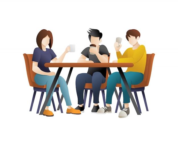 Молодые люди едят в ресторане