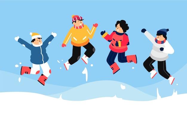 젊은 이들이 겨울 옷을 입고 점프