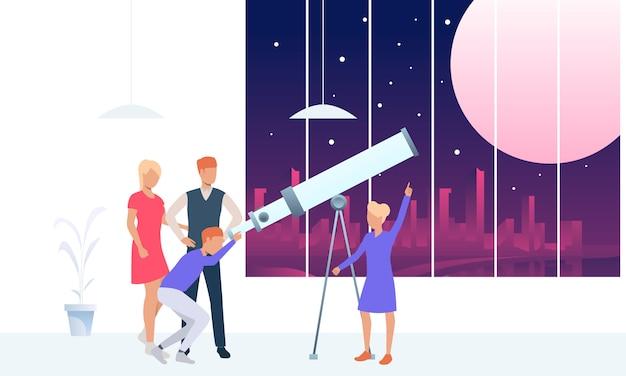 Молодые люди смотрят на луну через телескоп
