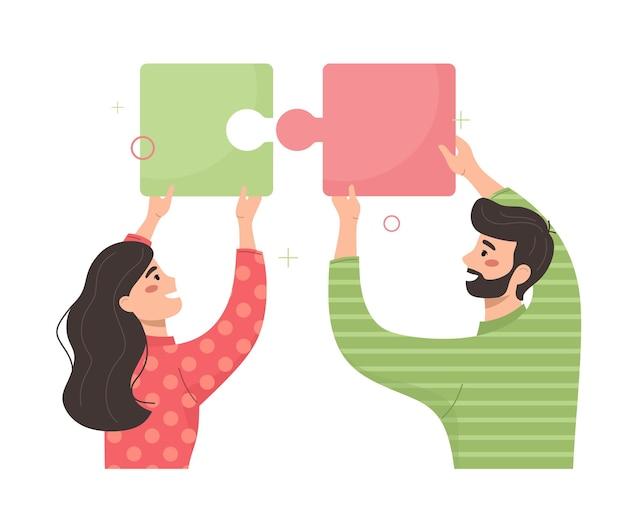 若い人たちがパズルを組み立てるビジネスプロジェクトのコミュニケーション
