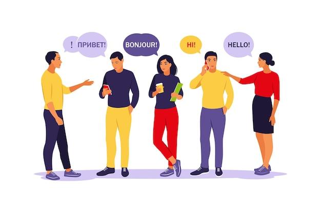さまざまな言語で挨拶する若者たち。ふきだしを持つ学生。コミュニケーション、チームワーク、接続の概念。