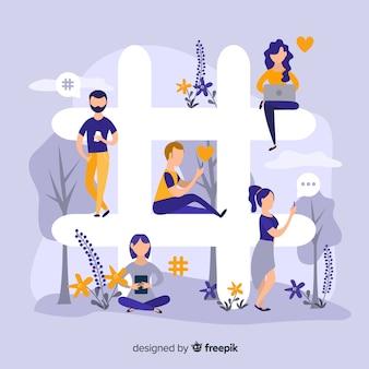 Молодые люди сидят на символе хэштега