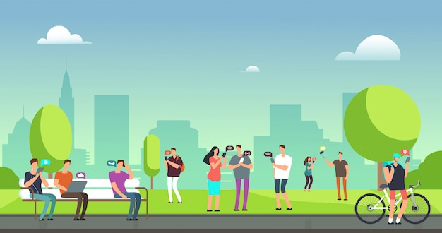 Young people using smartphones and tablets walking outdoors in park.