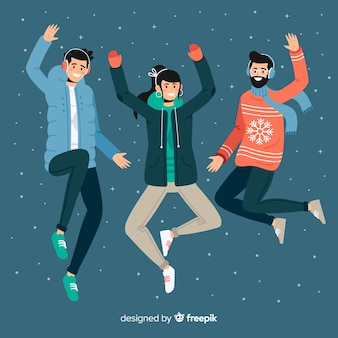 Young people wearing warm clothes and  jumping