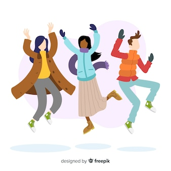 Young people wearing winter clothes jumping