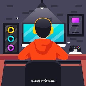 コンピューターで遊ぶ若い人