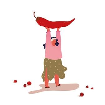 머리 위에 거 대 한 빨간 칠리 페 퍼를 들고 젊은 긍정적 인과 체중 여자