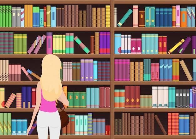 かなり金髪の若い女性は、図書館で本を選択します。