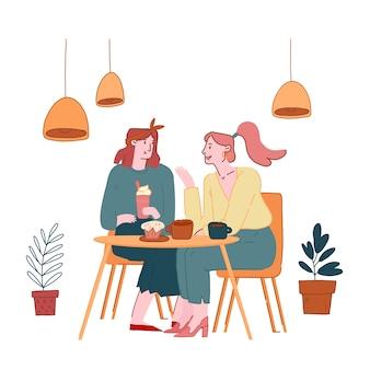 Молодые красивые девушки, сидя в кафе