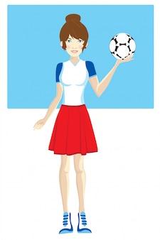 웃 고 축구 공을 들고 젊은 예쁜 여자