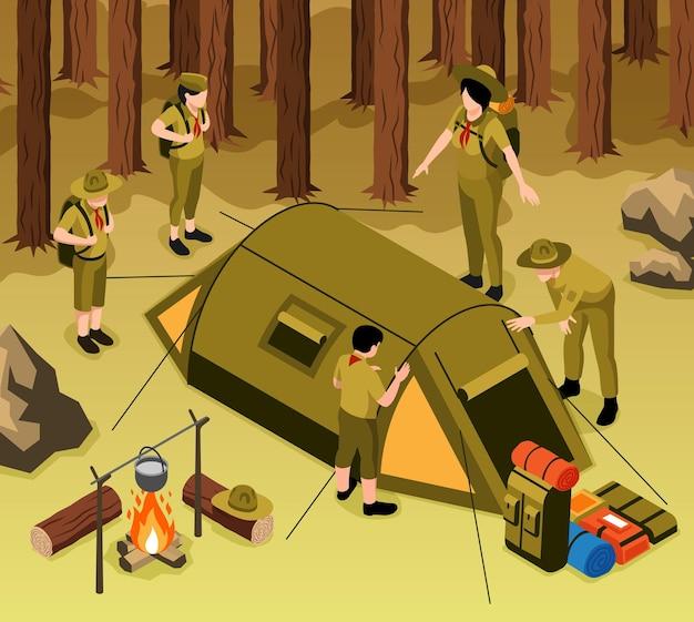 성인의 안내에 따라 휴식을 위해 숲에 캠프 텐트를 설치하는 젊은 스카우트