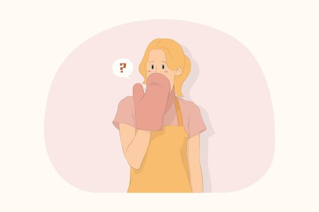 충격을 받은 젊은 셰프 쿡 제빵사 여성은 손 개념으로 팟홀더 커버 입을 입고 있다