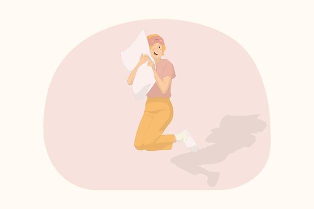 집에서 휴식을 취하는 젊은 잠자는 행복한 여성은 베개 개념으로 높은 수면을 취합니다.