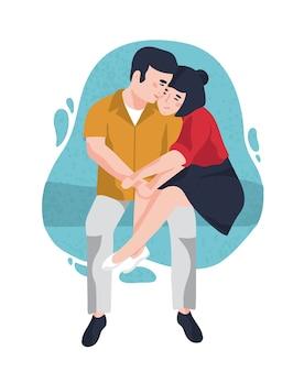 一緒に座って抱きしめる若い笑顔の男性と女性。かわいい面白い男の子と女の子が抱き締めます。愛の愛らしい幸せなカップル