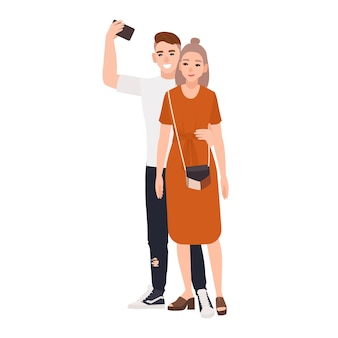 Young smiling man and woman standing together and taking selfie. happy romantic couple photographing themselves isolated
