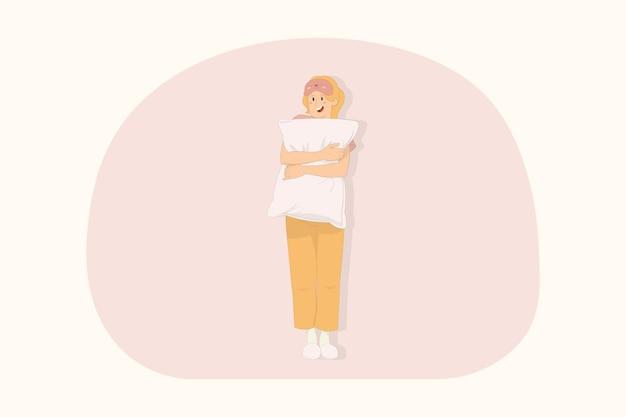 베개 개념을 들고 집에서 휴식을 취하는 젊은 웃는 여자