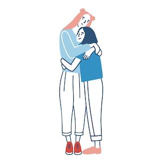 立って暖かく抱きしめたり抱きしめたりするカジュアルな服を着た若い笑顔の女性。女性の友人や姉妹