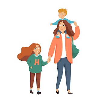 Young stylish mother or nanny, babysitter walking with kids, boy and girl