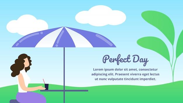 Young stylish woman sitting in restaurant outdoors under umbrella, enjoying drink