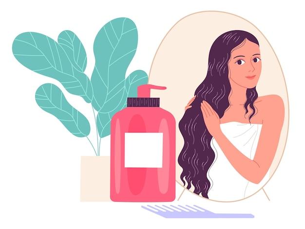 Молодая женщина наносит косметический продукт на волосы