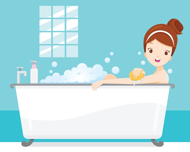 Young woman bathing in bathtub with soapsuds