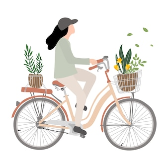 Young woman on bike. woman's riding bicycle with flower.