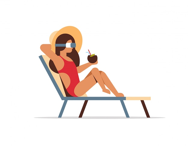 Young woman bikini on sun lounger wearing vr glasses holding coconut cocktail