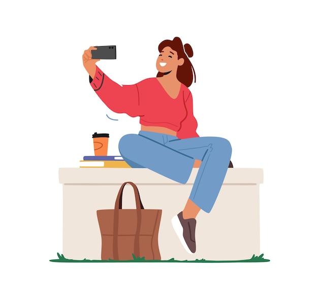 젊은 여자 캐릭터 포즈 및 휴대 전화 카메라에 촬영