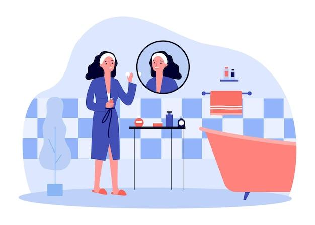 浴室の綿のパッドで顔を掃除する若い女性。朝のルーチンフラットベクトルイラストをやっている女性キャラクター。スキンケア、バナーの美容コンセプト、ウェブサイトのデザインまたはランディングウェブページ