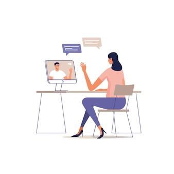 젊은 여자는 컴퓨터를 사용하여 온라인으로 통신합니다. 장치 화면에 남자.