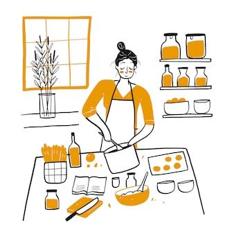 부엌에서 요리하는 젊은 여자.