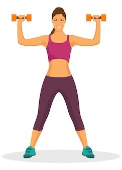 ジムでダンベルを使って運動をしている若い女性