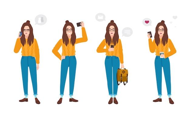 スマートフォンで流行の服を着た若い女性。