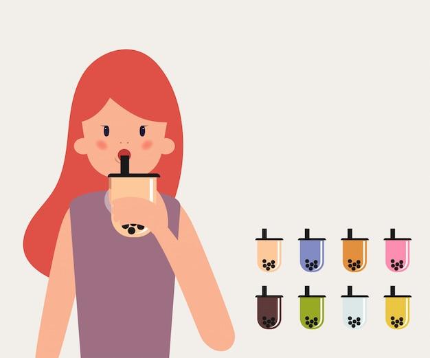 젊은 여자 음료 거품 우유 차.