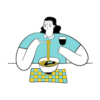 Young woman eating pasta and drinking wine