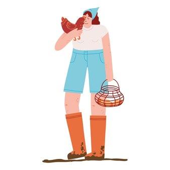 Молодая женщина-фермер держит курицу и корзину с яйцами.