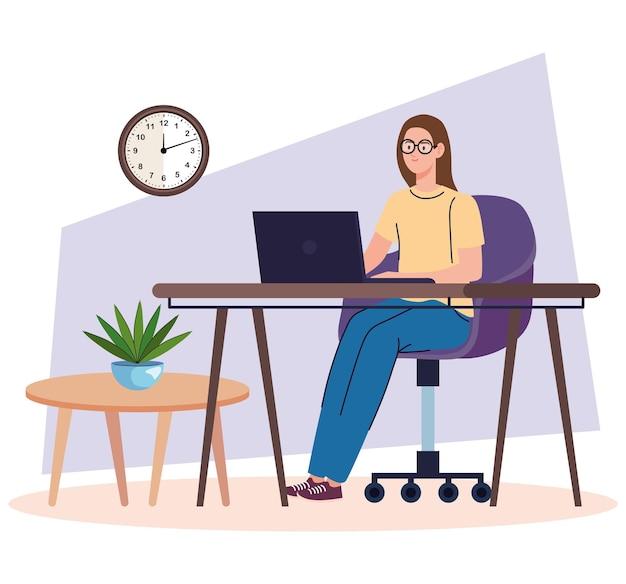 ノートパソコンを使用して机の上の若い女性フリーランサー労働者