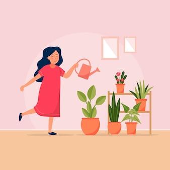 Giovane donna che fa il giardinaggio a casa