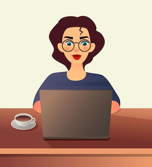 Young woman in glasses works at home sitting in front of a laptop