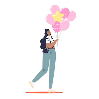 Young woman holding pink balloons