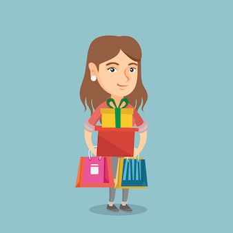 Young woman holding shopping bags and gift boxes.