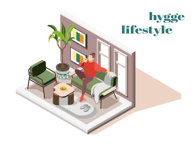 Молодая женщина в уютном свитере наслаждается образом жизни хюгге, потягивая горячий шоколад на диване изометрической композиции