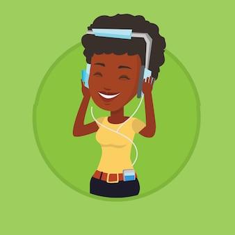음악을 듣고 헤드폰에 젊은 여자.