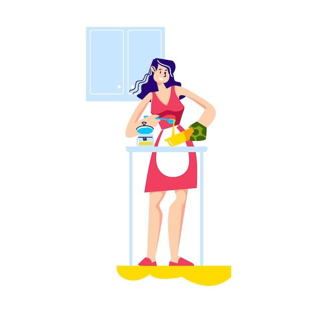 夕食のために食事を調理する台所の若い女性