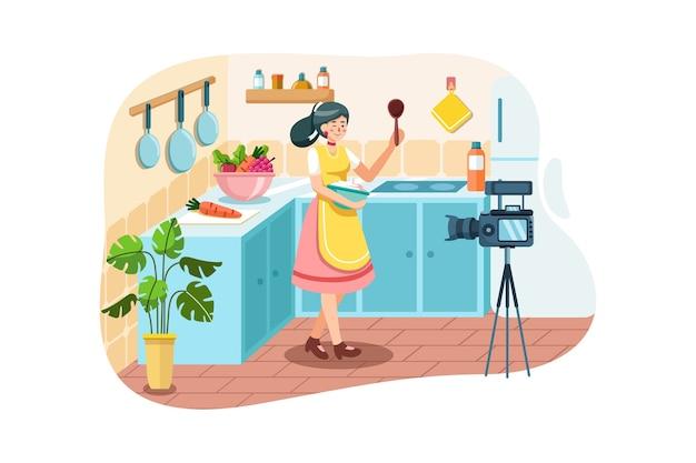 Молодая женщина в кухне записи видео на камеру.