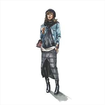 スタイリッシュな流行の服装の若い女性