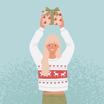 彼女の手でクリスマスプレゼントを持っているセーターの若い女性。フラットスタイルのイラスト
